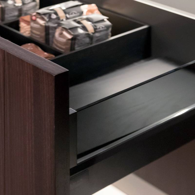 The ArciTech drawer with dark glass blends harmoniously into the kitchen's design.