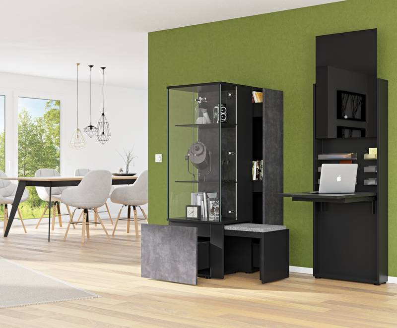 Megatrend towards urbanisation: living space is getting smaller, furniture with storage solutions all the more important, e.g. a home office that is hidden away in a piece of living room furniture. Photo: Hettich