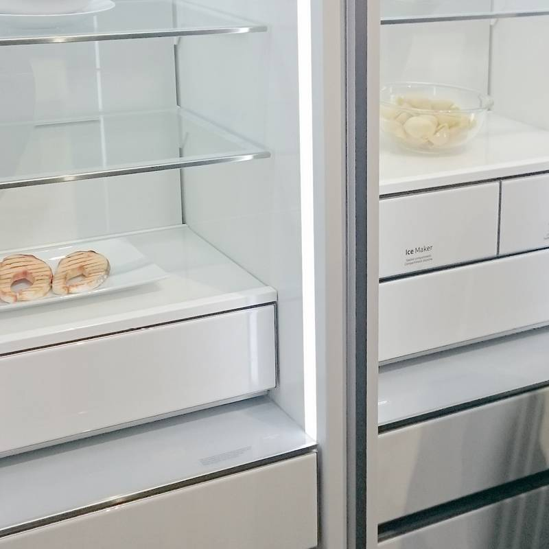 More and more, high quality materials, like glass, are finding their way into refrigerators, giving them a furniture like character.