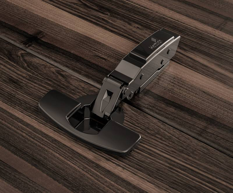 The Sensys fast assembly hinge in obsidian black discreetly blends into the design of dark furniture. Photo: Hettich