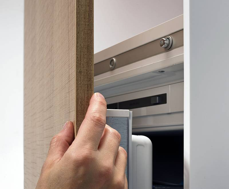 The door is not pulled closed by a separate magnet, reducing the risk of trapping fingers. Photo: Hettich