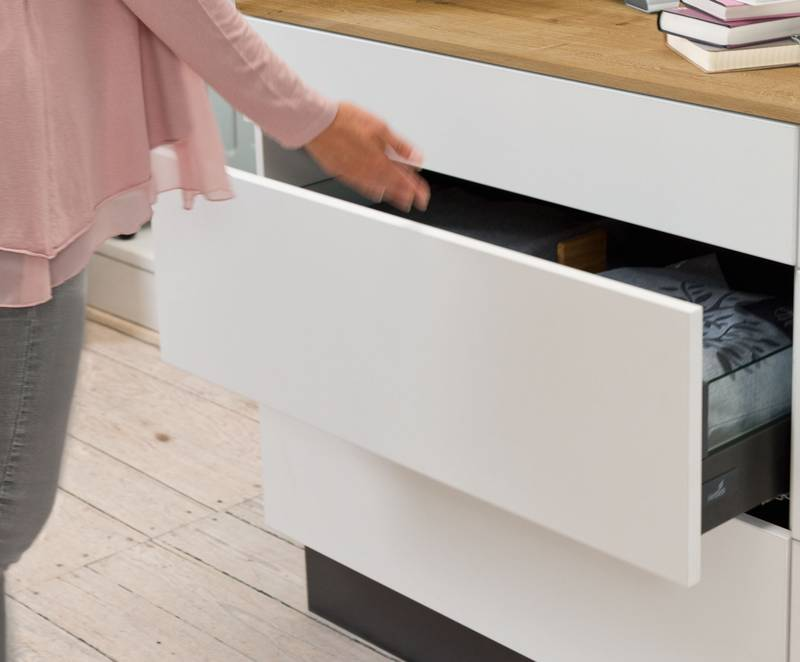 Push to open Silent from Hettich provides practical convenience in handleless furniture design. Drawers open and close reliably, gently and quietly. Photo: Hettich