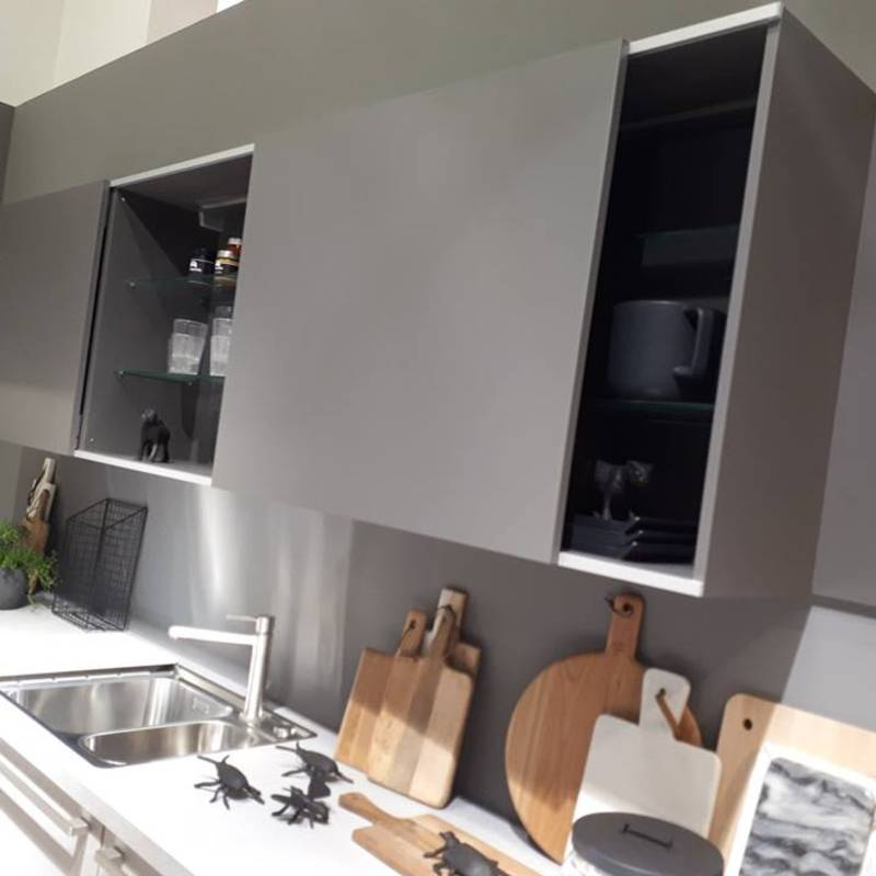 Overhead cabinets with folding and sliding doors are a must